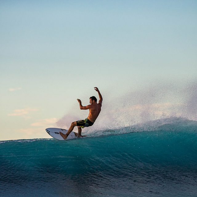 [All captions by the photographer] Joel Parkinson, Cloudbreak. You see a surfer's style in everything they do in the water—even in the way they kick out. Even though he's a world champion, he probably would have won even more heats had he not made things look so easy.